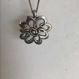Silver flower pendant necklace by Brighton .
